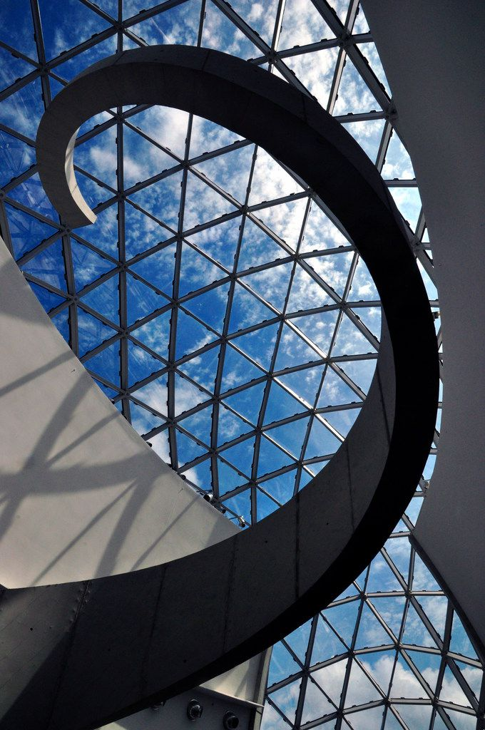 The atrium inside the Dali Museum in St. Petersburg, Fla., reflects the style of the Spanish artist.