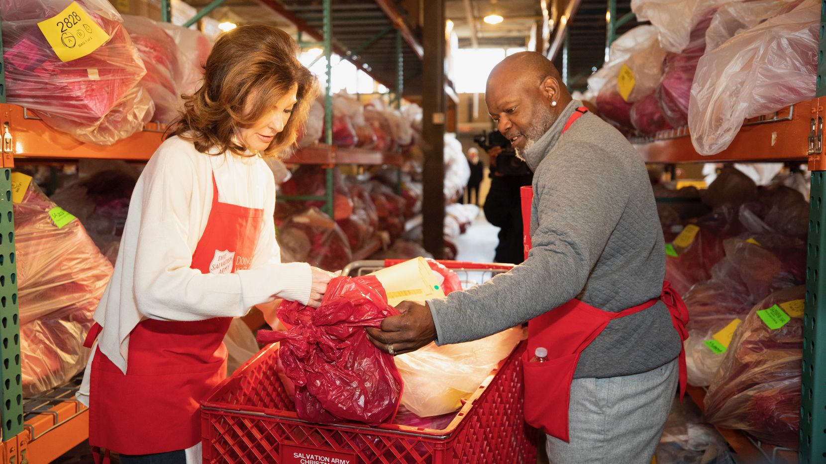 Charlotte Jones was joined by Dallas Cowboys Legend Emmitt Smith in sorting and distributing Salvation Army Angel Tree gifts for families in need at the nonprofit's Christmas Assistance Center in Dallas last December.