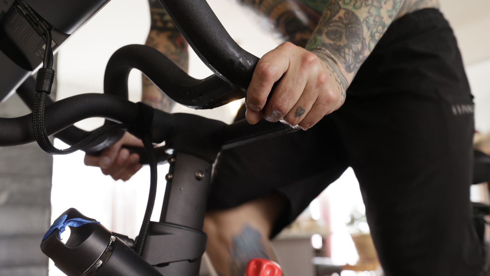 Brody Longo works out on his Peloton exercise bike in April in Brick, N.J.