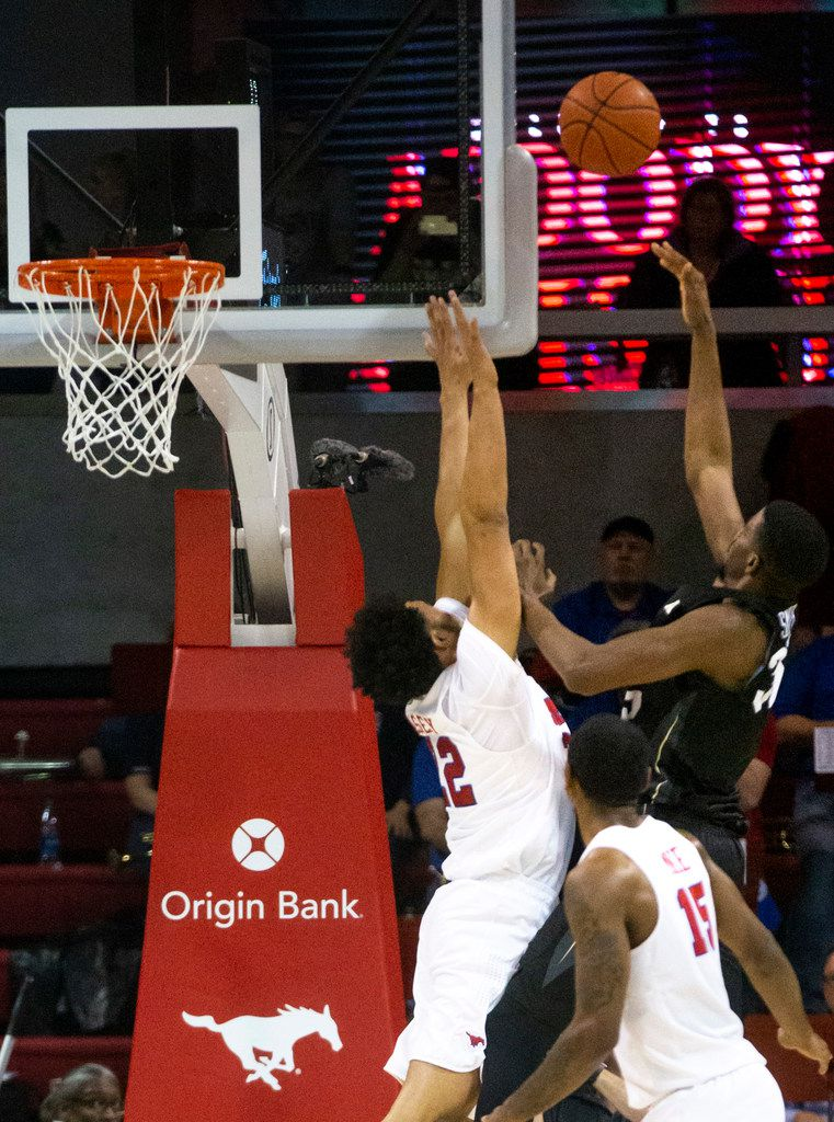 Southern Methodist Mustangs guard Darius McNeill (2) jumps to block a shot by UCF Knights forward Collin Smith (35) in the second half of an NCAA basketball game between the SMU Mustangs and the University of Central Florida Knights at Moody Coliseum in University Park, Texas, on Wednesday, Jan. 8, 2020.