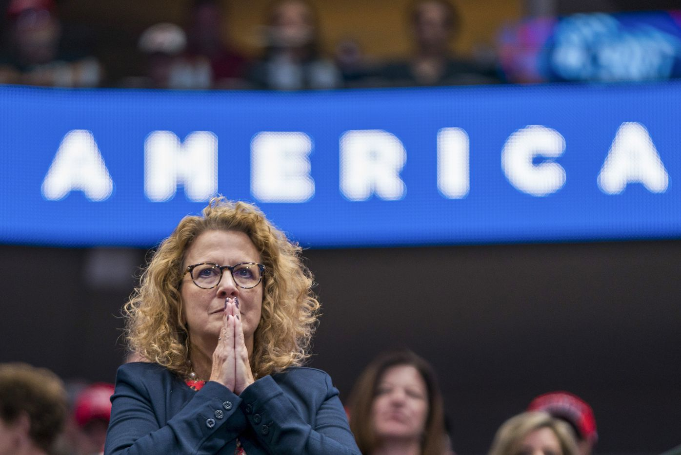 A woman listens as President Donald Trump speaks during a campaign rally at the American Airlines Center on Thursday, Oct. 17, 2019, in Dallas.