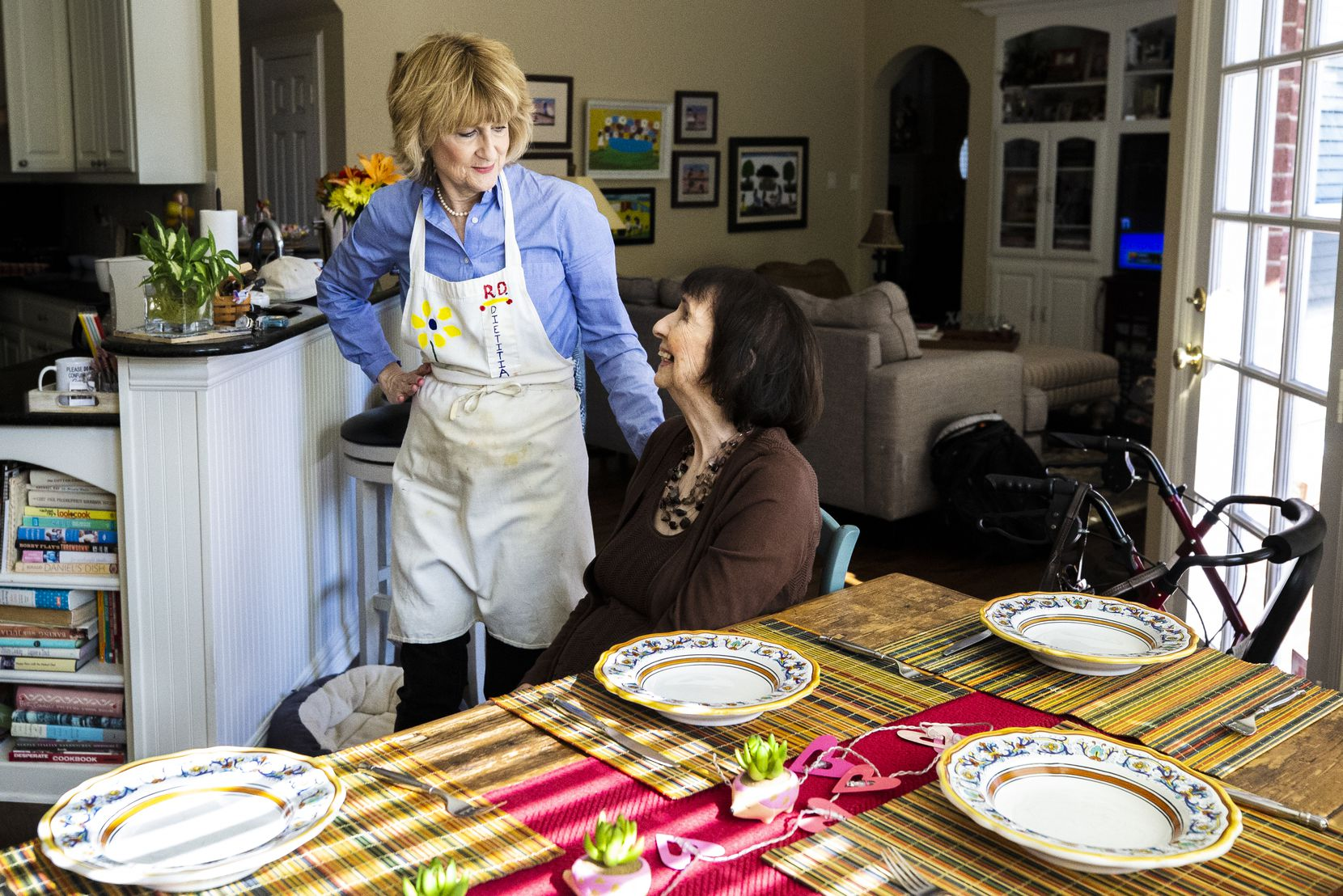 Carol Ireton-Jones, a private practice registered dietitian nutritionist, left, talks with her 95-year-old mother, Nina Ireton, while cooking spaghetti at her home in Carrollton on Jan. 25, 2019. Over the years, Carol has helped Nina with her nutrition and eats with her mother at least once a week.