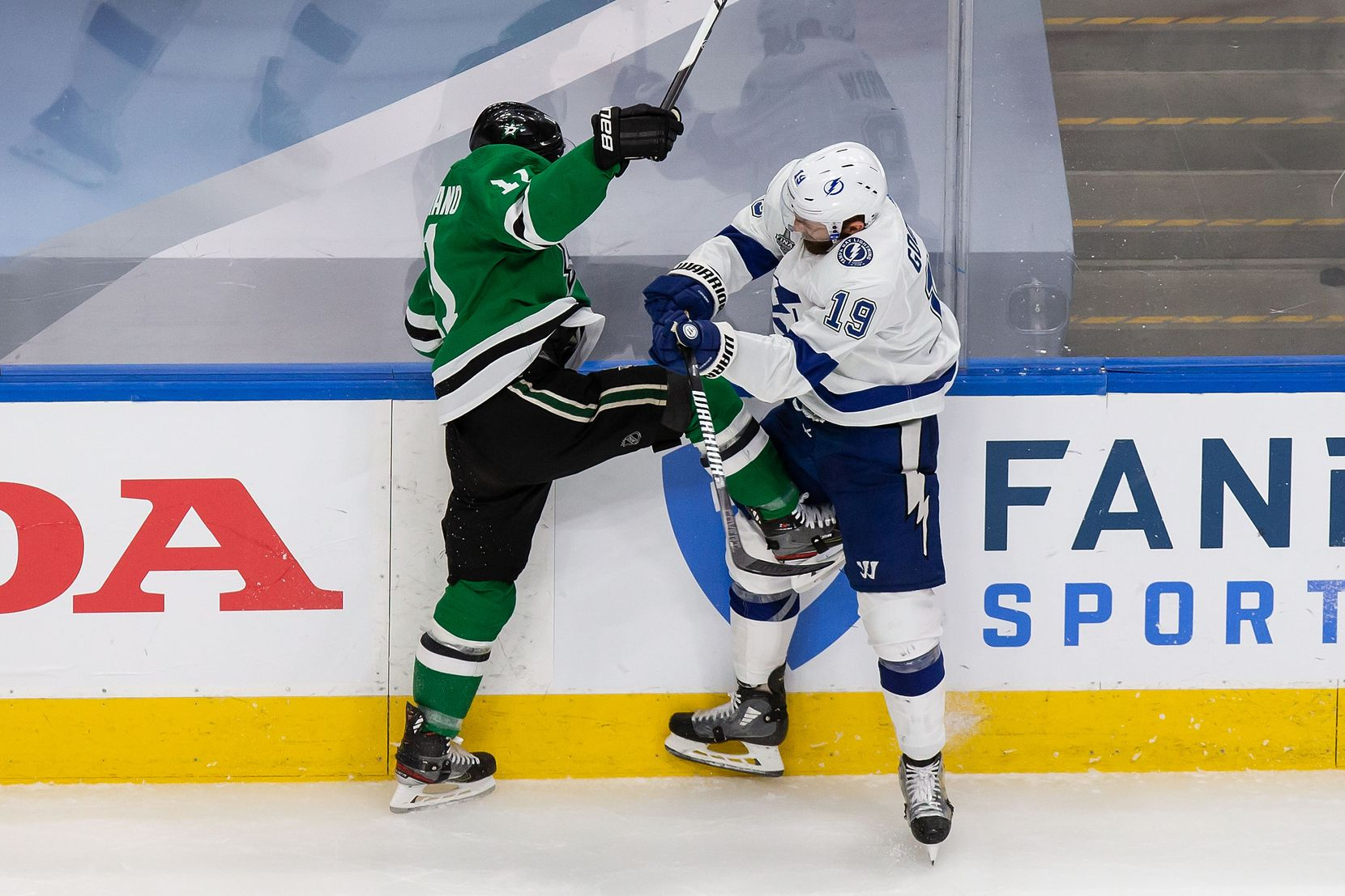 Nick Caamano (17) of the Dallas Stars gets his skate into Barclay Goodrow (19) of the Tampa Bay Lightning during Game Three of the Stanley Cup Final at Rogers Place in Edmonton, Alberta, Canada on Wednesday, September 23, 2020. (Codie McLachlan/Special Contributor)