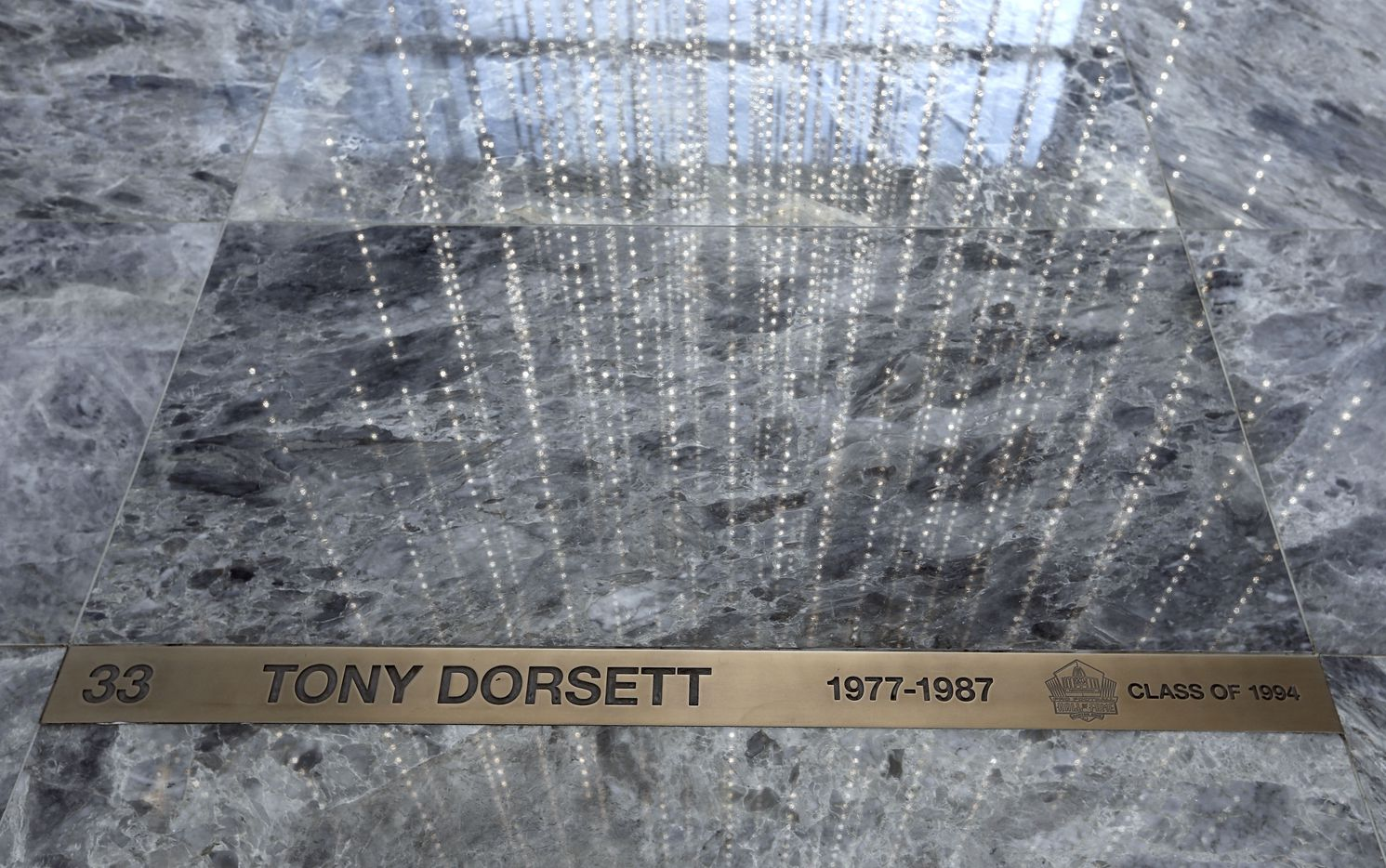 Marbled floor with former players' name plates — including Tony Dorsett — are featured in the floor of the Dallas Cowboys headquarters at The Star in Frisco.