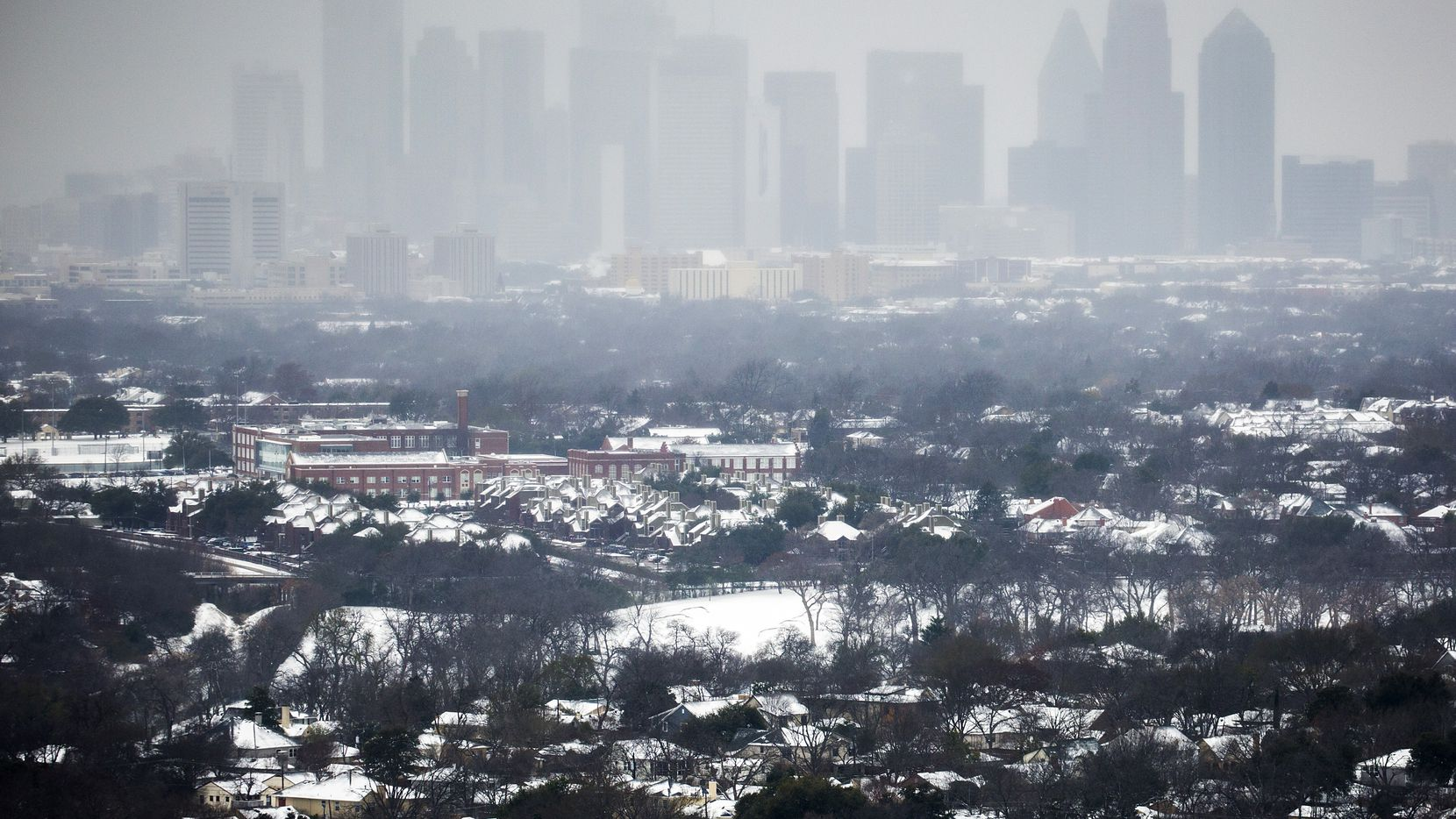 The downtown Dallas skyline was obscured as snow returned to North Texas on Feb. 27, 2015.