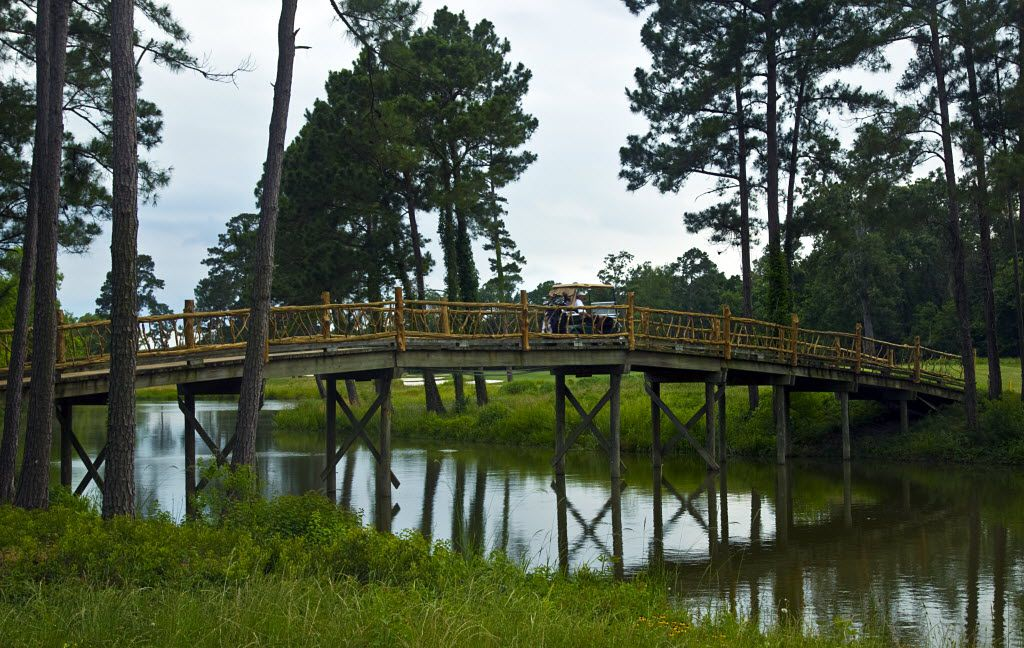 The wooden bridge from tee box to green on the par-3 No. 16  at Whispering Pines Golf Club in Trinity, TX, Wednesday, May 18, 2011.  (Tom Fox/The Dallas Morning News)