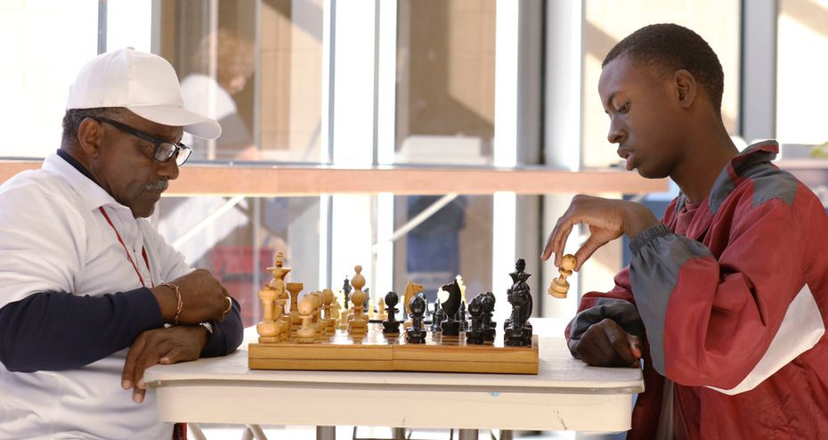 Donald Harris (left) plays chess with Duncanville High School student Gerald Watson during lunch in the school cafeteria.