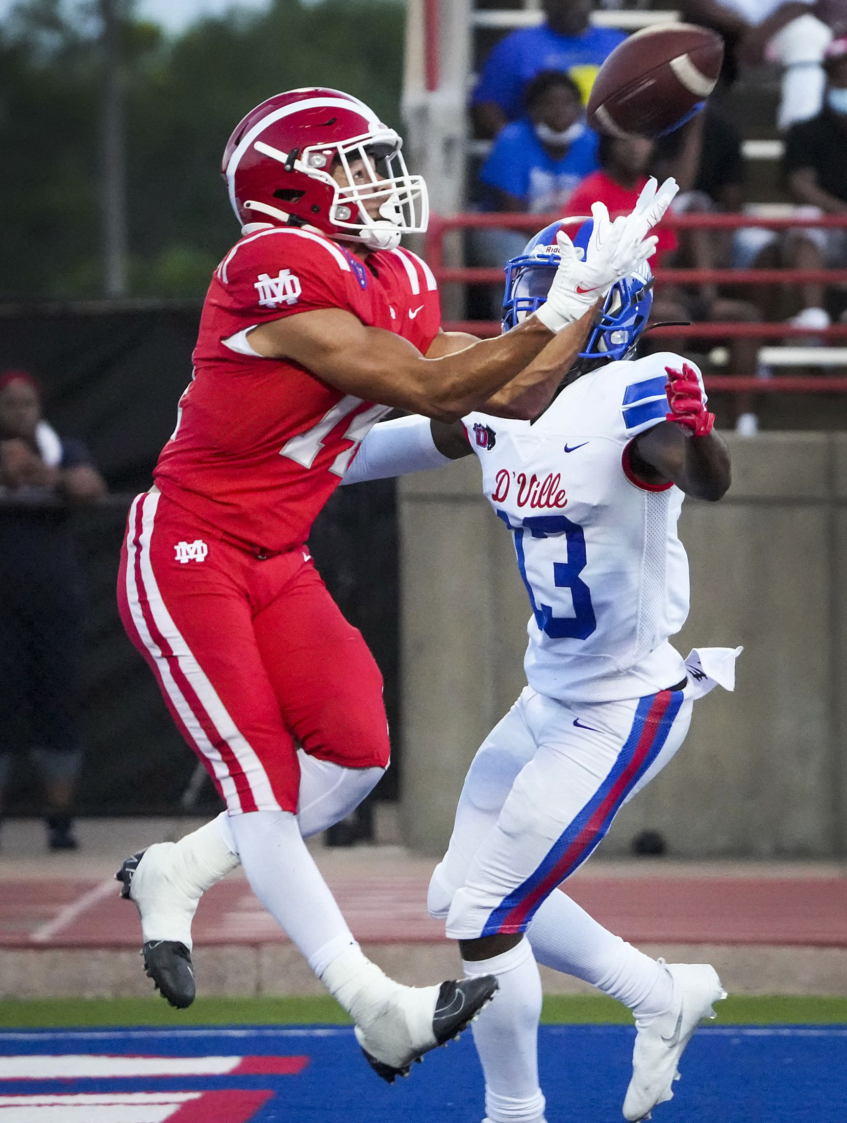 Mater Dei defensive back Joshua Hunter (14) intercepts a pass in the end zone intended for Duncanville wide receiver Chris Hicks (13) during the first half of a high school football game on Friday, Aug. 27, 2021, in Duncanville. (Smiley N. Pool/The Dallas Morning News)