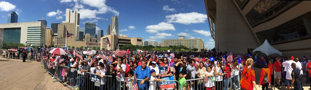 People begin to fill up the area in front of the stage in front of Dallas City Hall during Mega March in Dallas on Sunday, April 9, 2017.