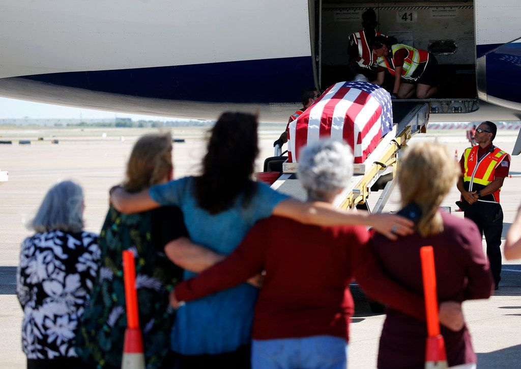 Family and friends watch as the remains of Marine Corps  Pfc. Grady J. Crawford at DFW Airport on Friday, September 27, 2019. Crawford, 21, of Dallas, was killed in the Korean War during the famous battle of the Chosin Reservoir on Dec. 1, 1950. His body was missing until this year when his remains were identified.