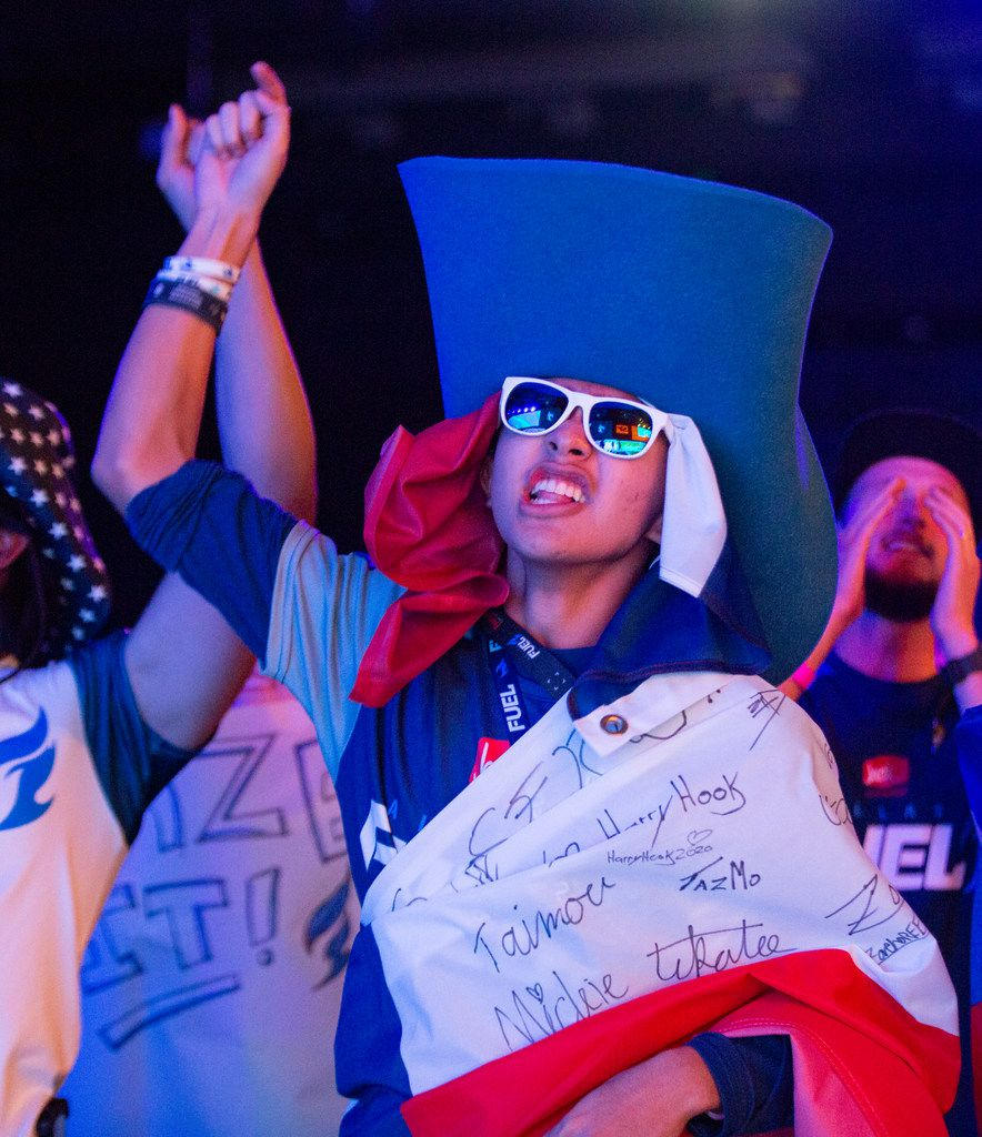 A fan celebrates the Dallas Fuel's third map lead during the season three opening weekend match of the Overwatch League against the San Francisco Shock on Feb. 9, 2020 at the Esports Stadium in Arlington. The Fuel lost 3-1. (Juan Figueroa/ The Dallas Morning News)