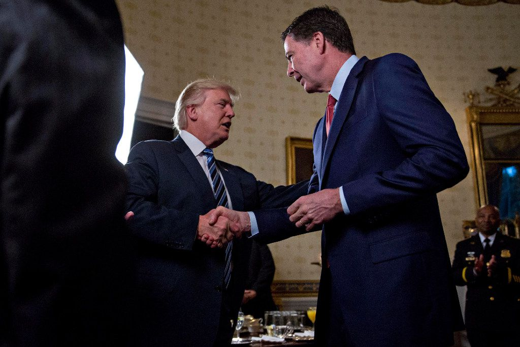U.S. President Donald Trump meet with James Comey during an Inaugural Law Enforcement Officers and First Responders Reception in the White House in January.