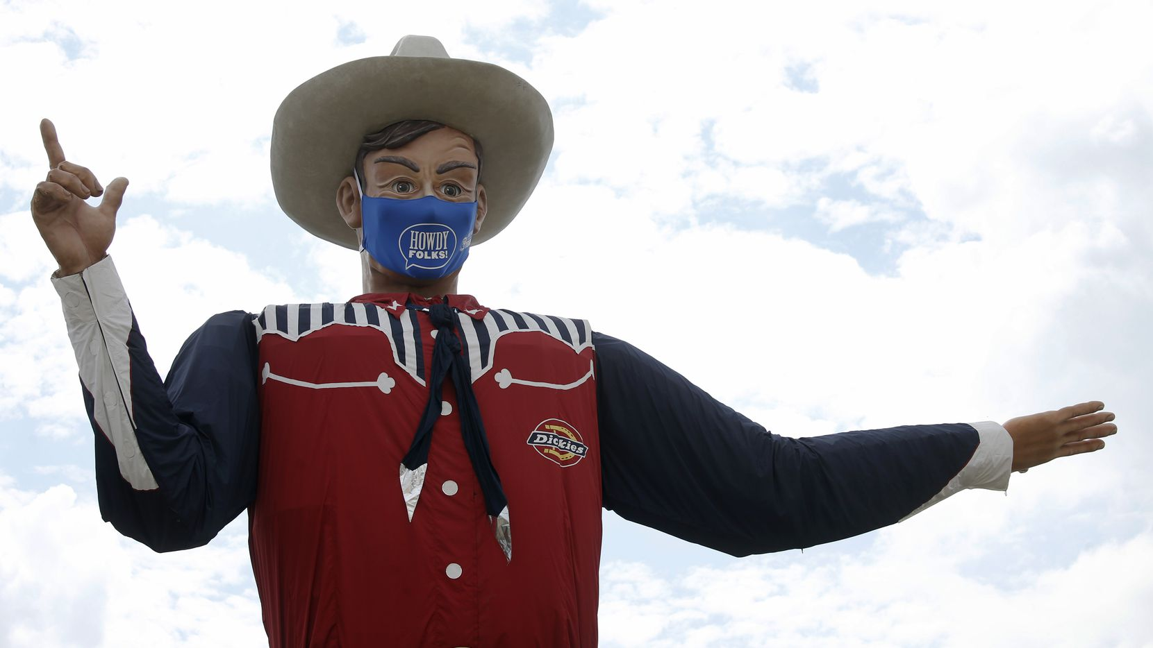 Big Tex sports a howdy folks face mask at Fair Park in Dallas on Wednesday, September 16, 2020. The mask is 84 inches by 45 inches or roughly 7 feet by 4 feet. The State Fair of Texas has been cancelled this year due to the global pandemic. The State Fair of Texas will open on weekends selling drive-thru fair food and photos with Big Tex in September and October. (Vernon Bryant/The Dallas Morning News)