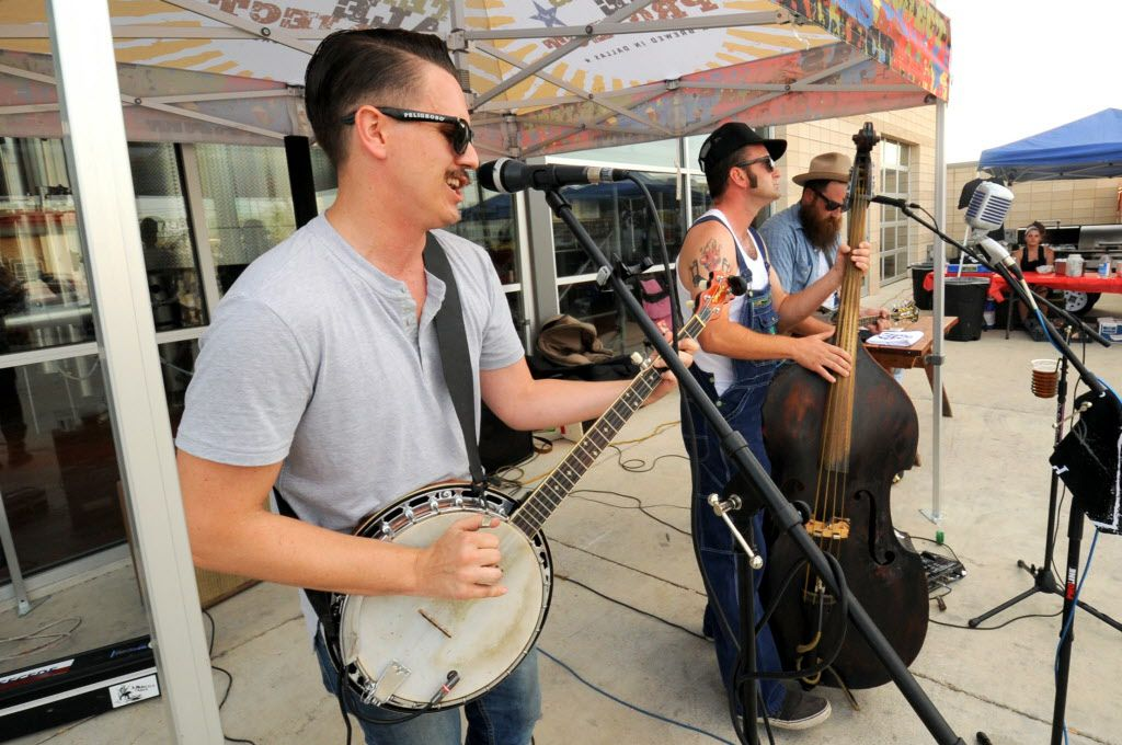 Walker and the Texas Dangers entertain the crowd with folk music at the custom car show at Texas Ale Project in Dallas, TX on August 15, 2015.