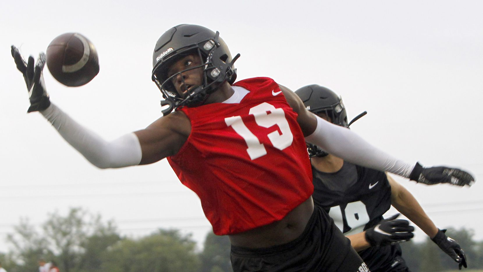 Argyle receiver Jaaquan Felton (19), exhibits sharp focus as he pulls in a pass during a position drill session. Argyle's first day of football practice began at 6 a.m. at their new high school campus on Canyon Falls Drive in Argyle on August 2, 2021.