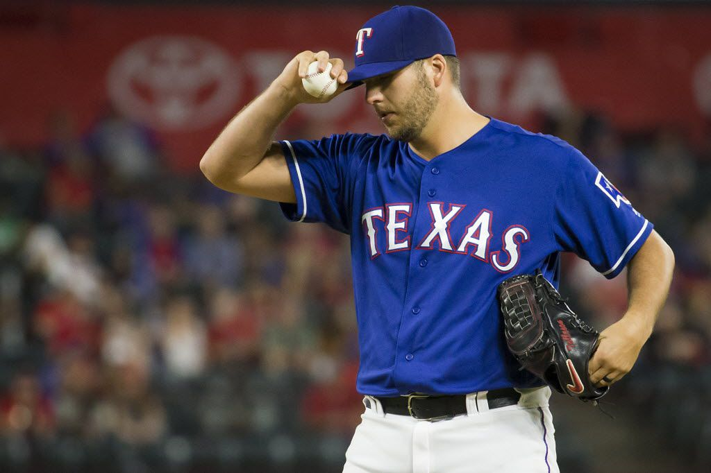 Texas Rangers relief pitcher Shawn Tolleson adjusts his cap as he comes in to pitch the ninth inning against the Los Angeles Angels at Globe Life Park on Friday, April 29, 2016, in Arlington, Texas. (Smiley N. Pool/The Dallas Morning News)