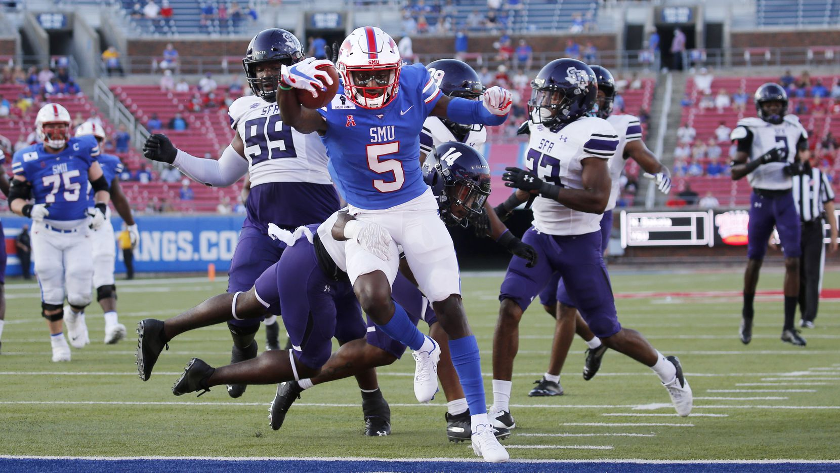 Southern Methodist Mustangs wide receiver Danny Gray (5) scores a touchdown as Stephen F. Austin Lumberjacks defensive back Kris McCune (14) fails to stop him during the first half of their home opener at Ford Stadium in Dallas, on Saturday, September 26, 2020. (Vernon Bryant/The Dallas Morning News)