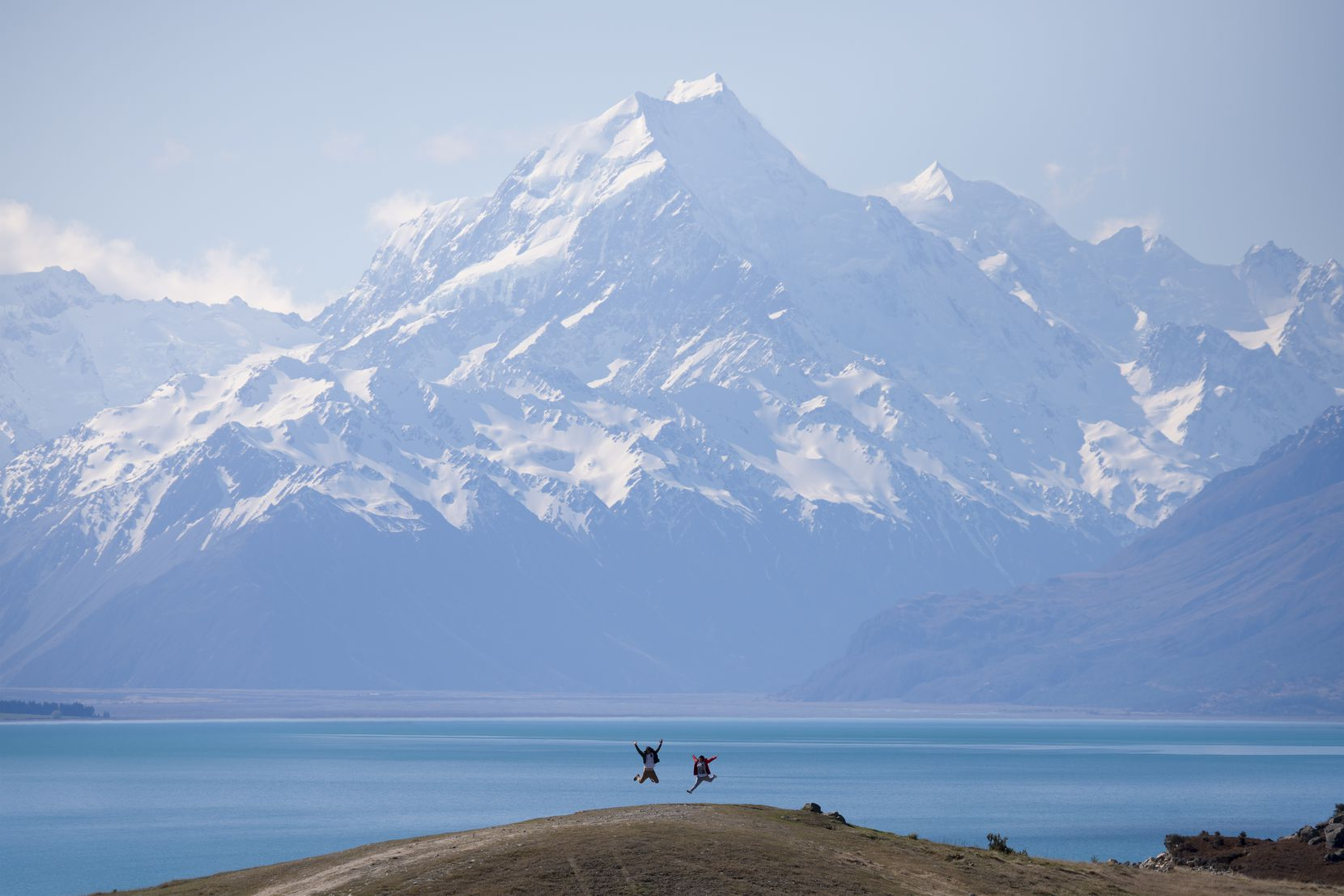 Mount Cook towers above the surrounding landscape and Lake Pukaki. At 12,218 feet, Mount Cook is the highest mountain in New Zealand.