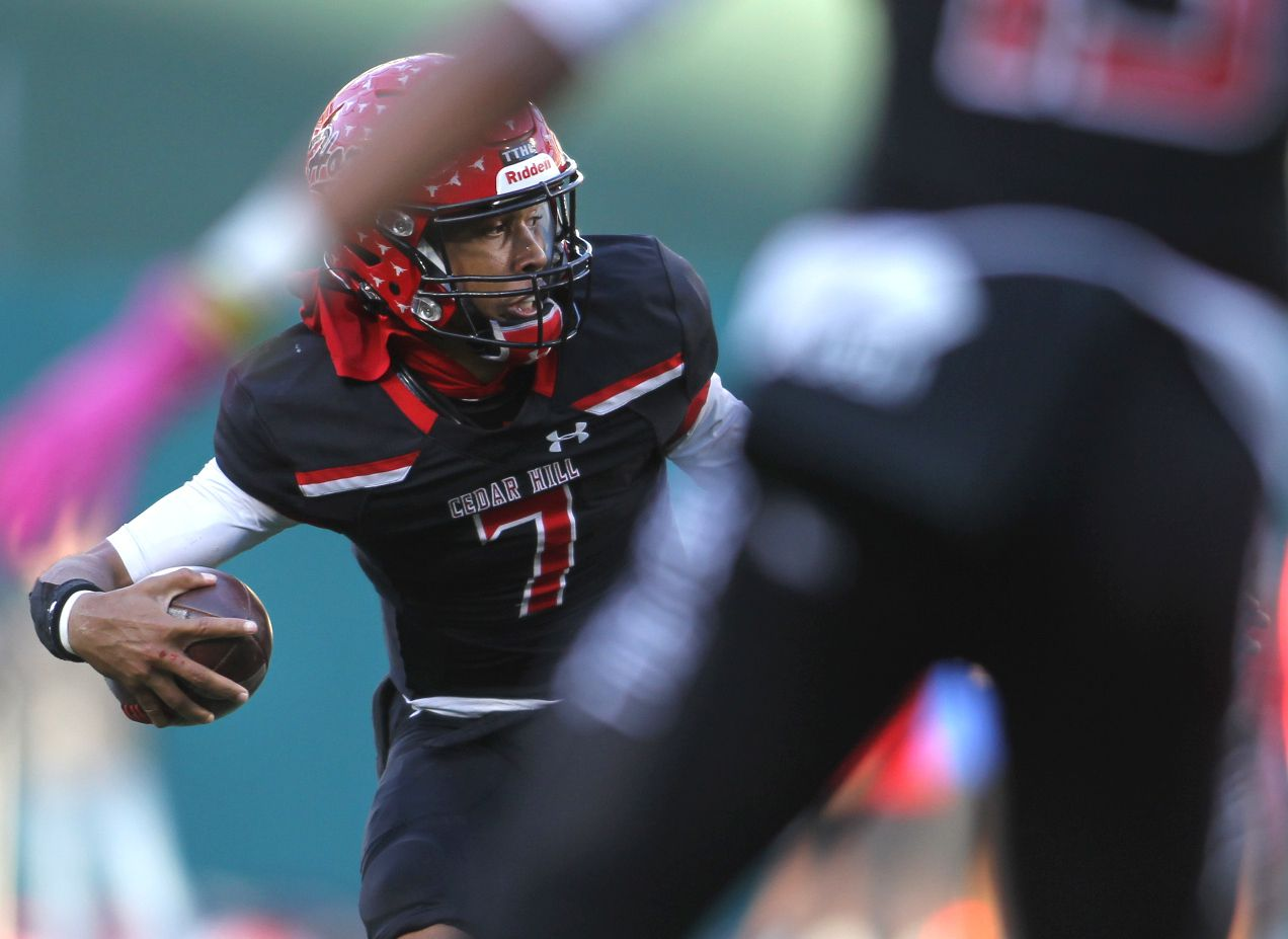 Cedar Hill quarterback Kaidon Salter (7) reverses his field on a quarterback keeper during first quarter action against Rockwall Heath. The two teams played their Class 6A Division ll Region ll final football playoff game at Globe Life Park in Arlington on January 2, 2021. (Steve Hamm/ Special Contributor)