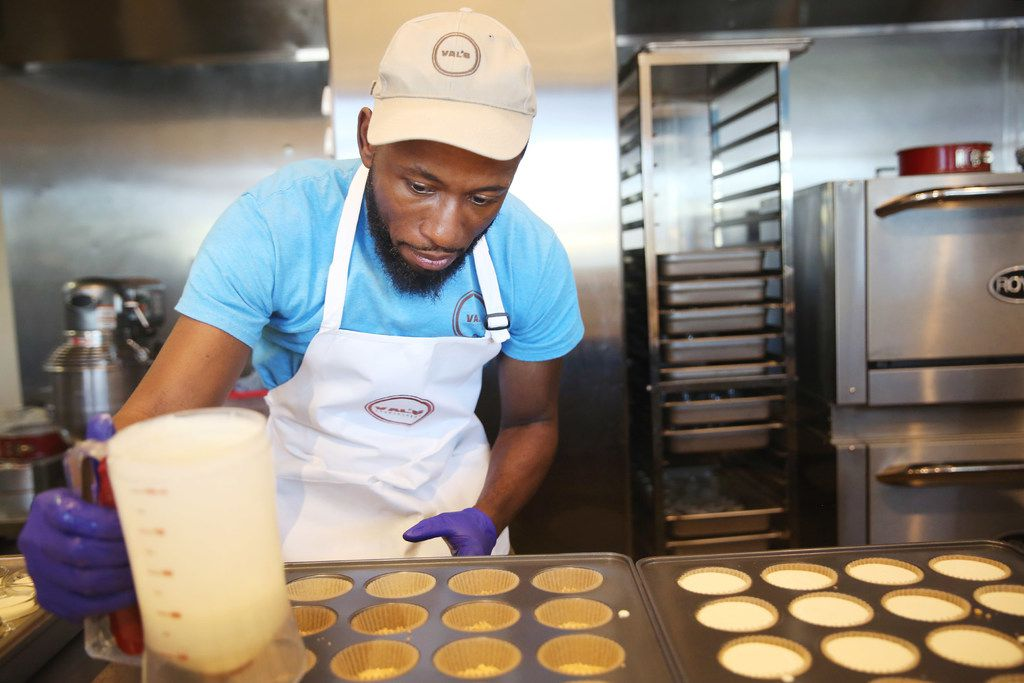 Valery Jean-Bart prepares a cheesecake cupcake in the kitchen of his Greenville Avenue Val's Cheesecakes shop.