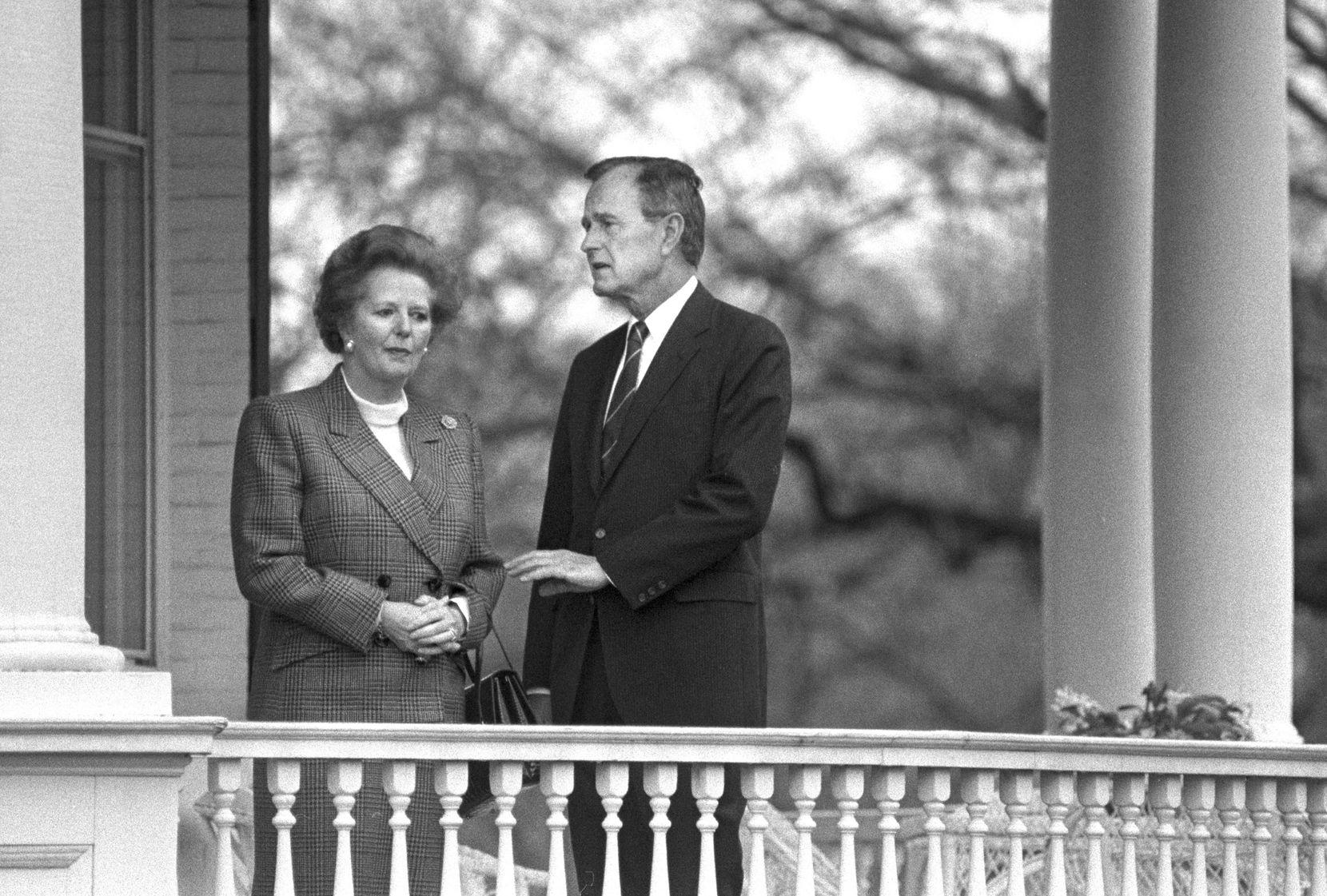 1988: President-elect George H.W. Bush speaks with British Prime Minister Margaret Thatcher in Washington.