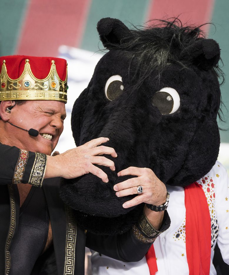 Guest picker Jerry 'The King' Lawler grabs the headgear of SMU mascot Peruna worn by Lee Cosro, after he picked the Mustangs for victory over Memphis during ESPN College GameDay on Saturday, Nov. 2, 2019, in Memphis, Tenn.