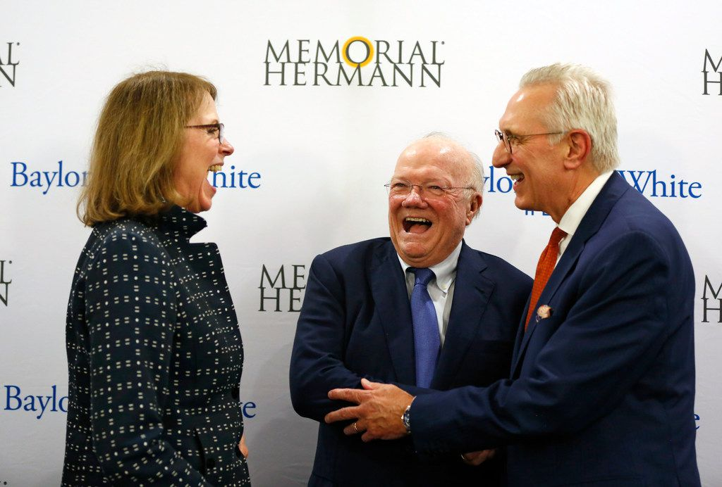 From left, Deborah Cannon, Memorial Hermann Health System board of directors chair; Ross McKnight, Baylor Scott and White board of trustees chair, and Chuck Stokes, Memorial Hermann Health System's president and CEO, laugh after a press conference announcing the merger between Baylor Scott and White Health and Memorial Hermann Health System on Monday, October 1, 2018, at Baylor Charles A. Sammons Cancer Center in Dallas. (Daniel Carde/The Dallas Morning News)
