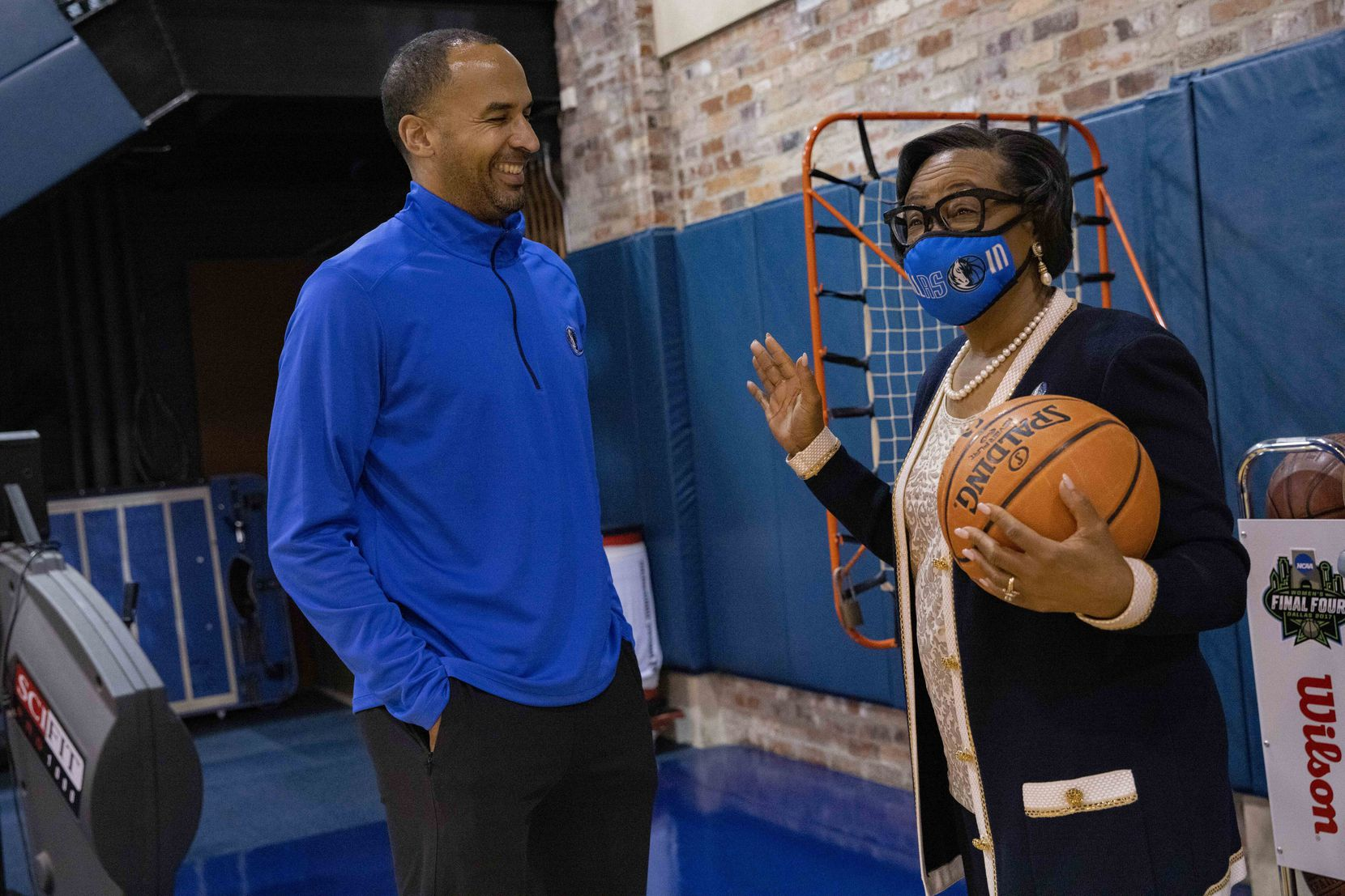 Dallas Mavericks GM Nico Harrison (left) chats with Mavericks CEO Cynt Marshall on Tuesday, Sept. 21, 2021, at American Airlines Center in Dallas. (Juan Figueroa/The Dallas Morning News)