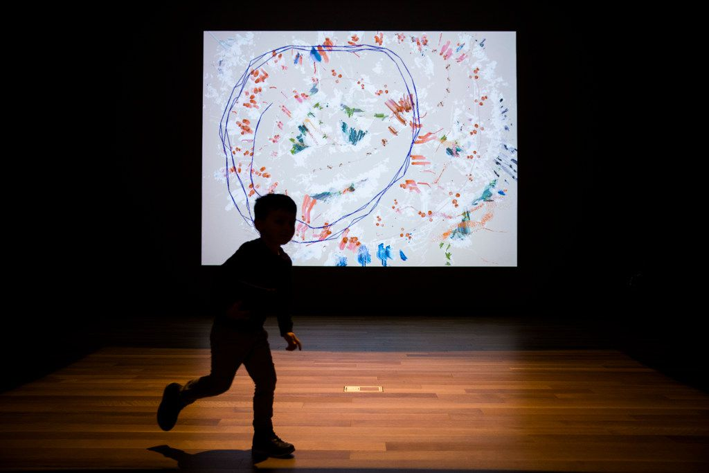 Ashton Morgan, 4, runs in circles in an interactive art exhibit on the second floor of the Amon Carter Museum of American Art.