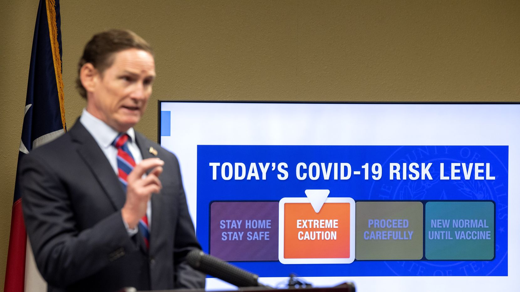 Dallas County Judge Clay Jenkins announced a shift from red to orange in the COVID-19 risk level during a news conference Wednesday, Sept. 2 at the Dallas County Emergency Operations Center in Dallas. (Jeffrey McWhorter/Special Contributor)