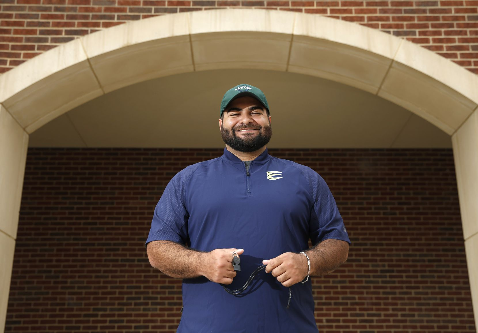 Marco Regalado poses for a portrait at Northwest Eaton High School in Haslet, Texas on Monday, July 6, 2020. Regalado drew the attention of Northwest Eaton head coach Ellis Miller, who then hired him to be an assistant football coach in DFW.