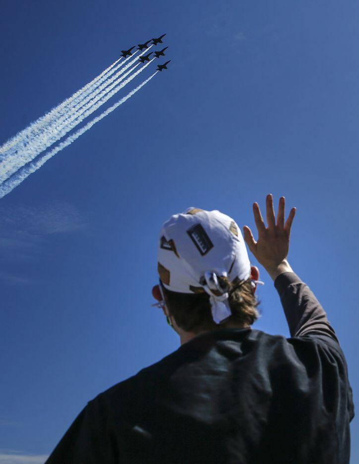"Nathan Golub, a Navy veteran and operations manager at Baylor University Medical Center, watches as the U.S. Navy's Blue Angels fly over downtown Dallas as part of their ""America Strong"" tour on Wednesday, May 6, 2020. 'It's really an honor,' Golub said. 'It means a lot to see the Blue Angels do this to celebrate the frontline workers and our community.'"