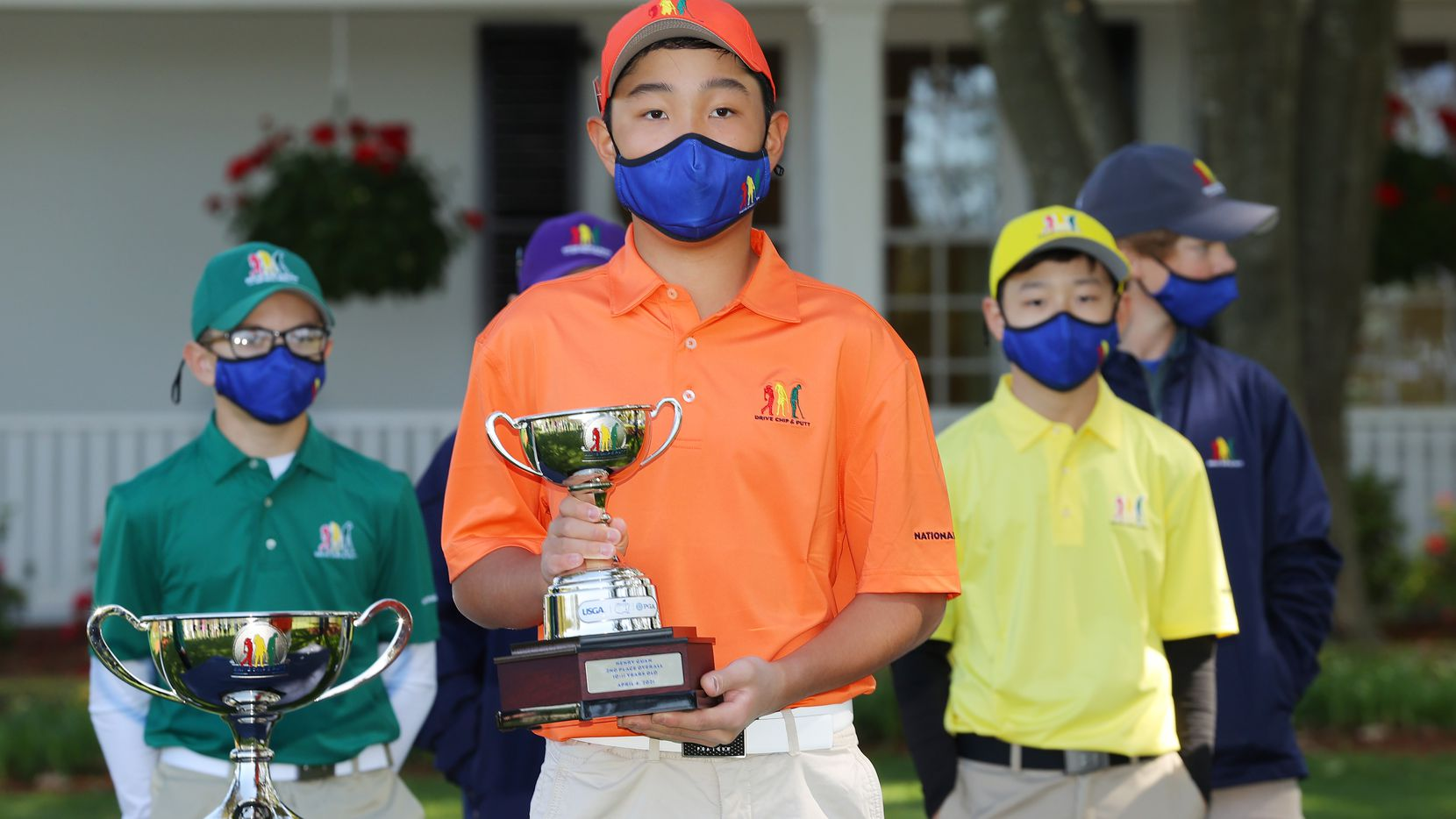 AUGUSTA, GEORGIA - APRIL 04:  Henry Guan, participant in the boys 10-11, poses with his second place overall trophy during the Drive, Chip and Putt Championship at Augusta National Golf Club on April 04, 2021 in Augusta, Georgia. (Photo by Kevin C. Cox/Getty Images)