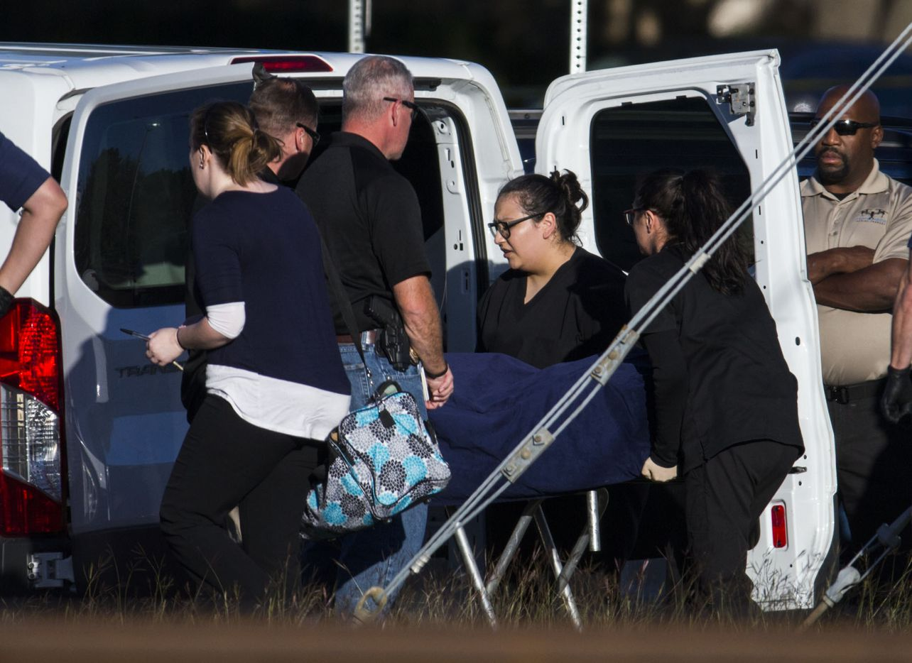 A stretcher is moved from the location where the location where the body of a young child was found on Sunday, October 22, 2017 in Richardson, Texas. It has not been confirmed if the body was missing three-year-old Sherin Mathews.