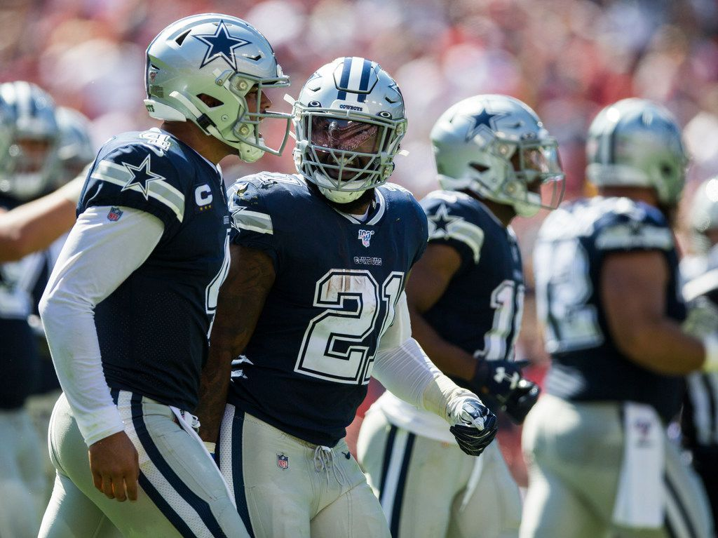 Dallas Cowboys quarterback Dak Prescott (4) and running back Ezekiel Elliott (21) celebrate a touchdown during the second quarter of an NFL game between the Dallas Cowboys and the Washington Redskins on Sunday, September 15, 2019 at FedExField in Landover, Maryland.