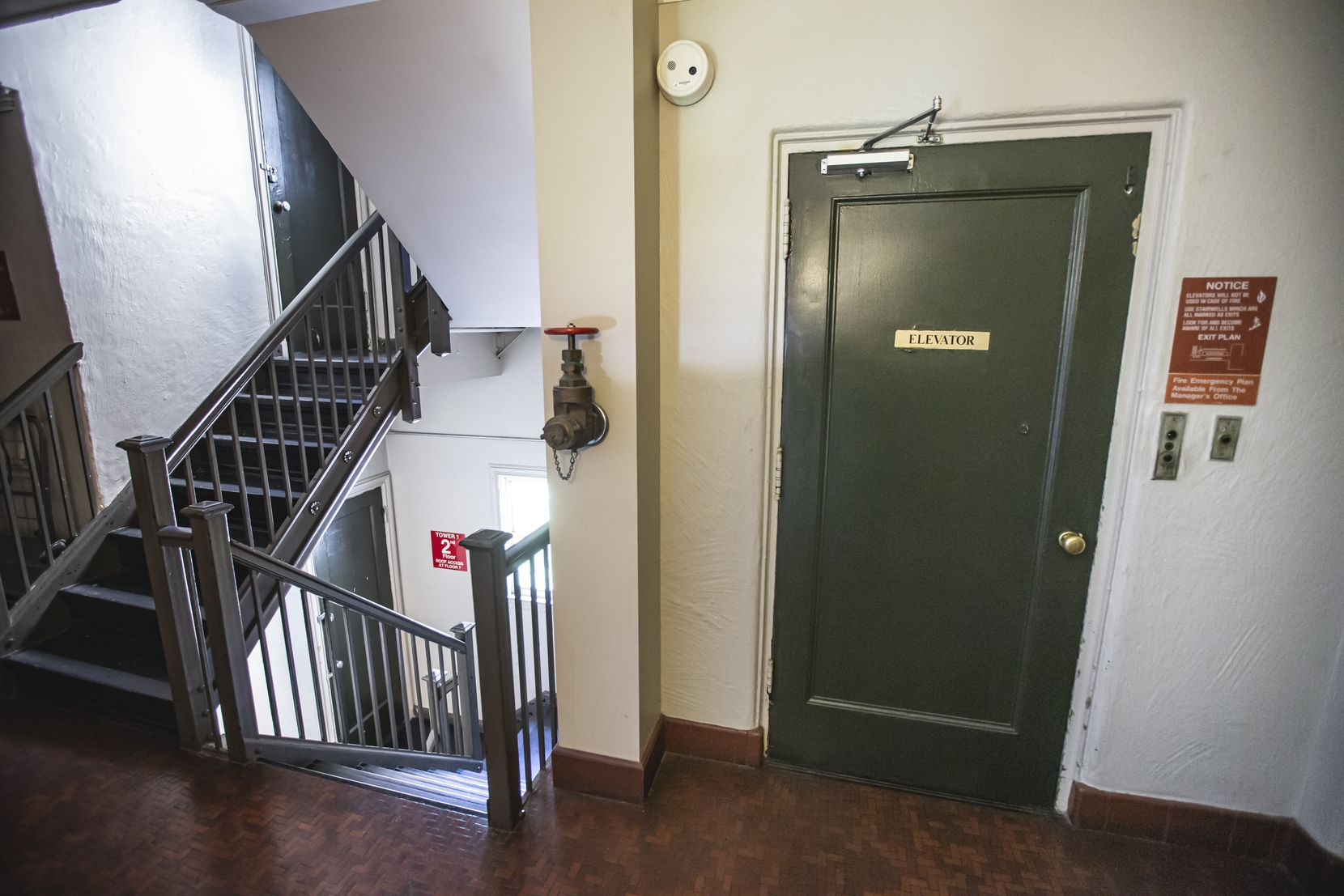 Each landing has 14 steps, so with the broken elevators, someone living on the 7th floor would have to climb 98 steps.