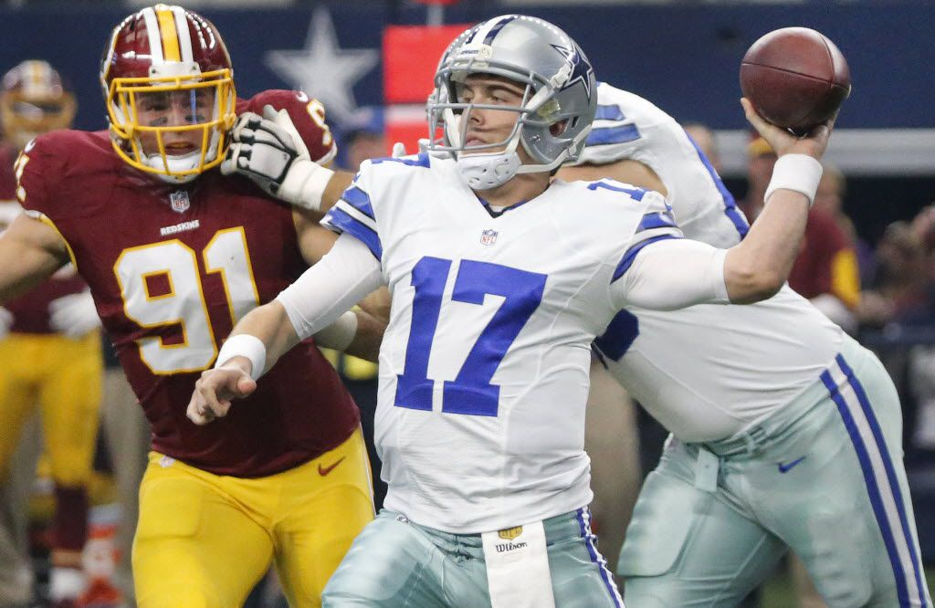 Dallas Cowboys quarterback Kellen Moore (17) throws a first-half pass under pressure from Washington Redskins outside linebacker Ryan Kerrigan (91) during the Washington Redskins vs. the Dallas Cowboys NFL football game at AT&T Stadium in Arlington on Sunday, January 3, 2016. (Louis DeLuca/The Dallas Morning News)