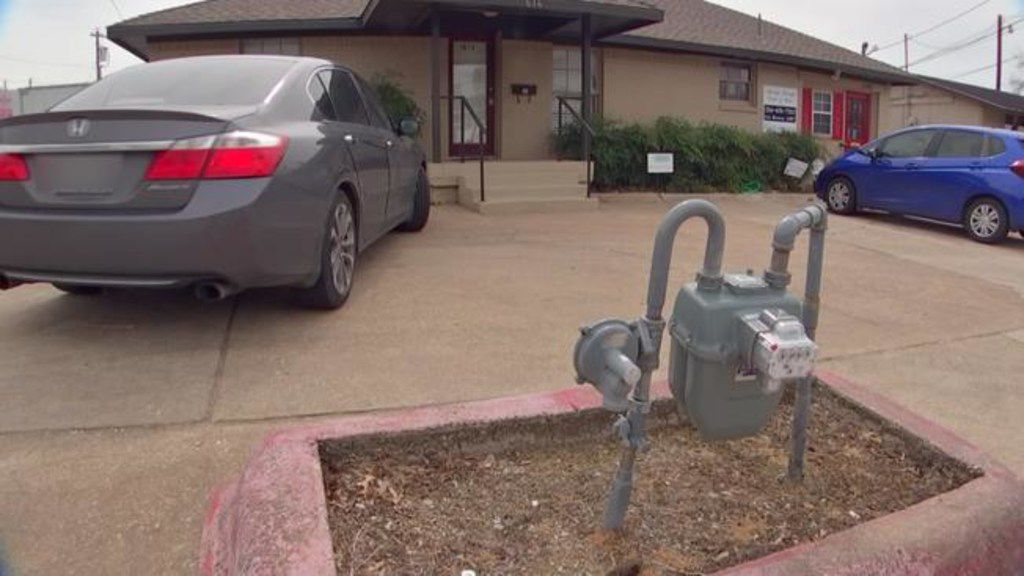 This natural gas meter stands right by an office parking lot in Plano, a few feet from the road. Atmos Energy, which owns the meter, said it's been working with the gas customer there to move the meter away from the road and closer to the building.