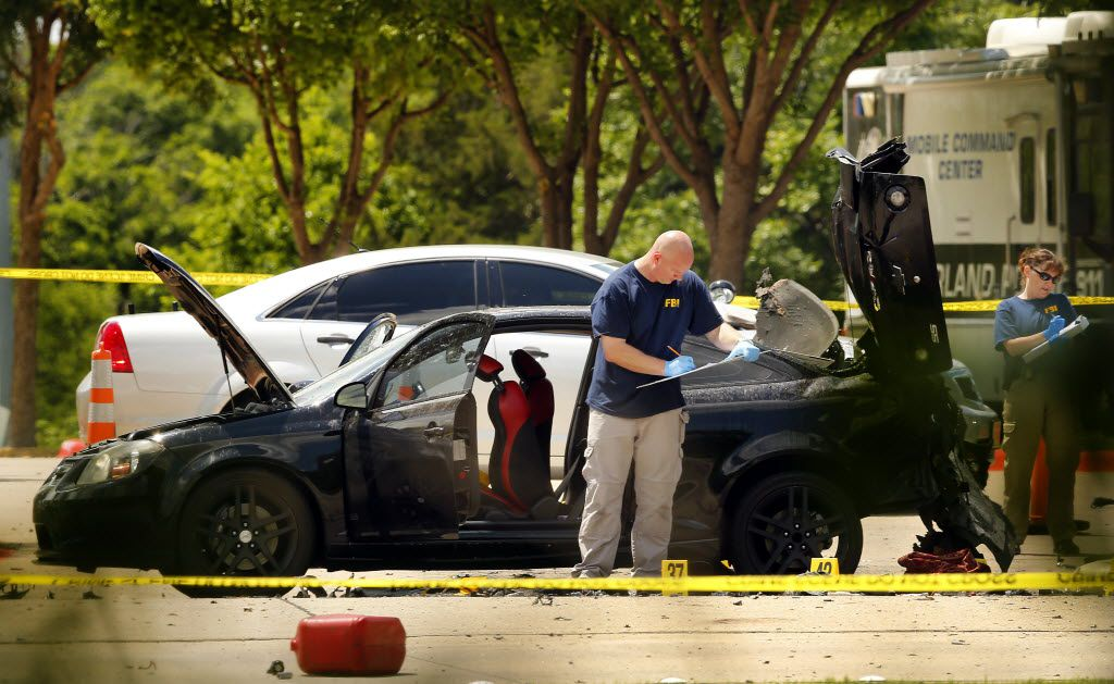 Members of the FBI Evidence Response team document the crime scene on May 4, 2015, outside the Curtis Culwell Center in Garland.