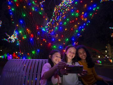 Friends take a selfie at Vitruvian Lights at Vitruvian Park.