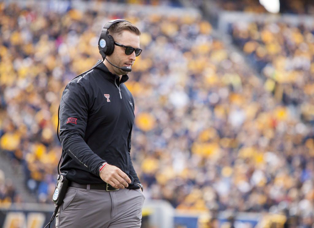 Nov 7, 2015; Morgantown, WV, USA; Texas Tech Red Raiders head coach Kliff Kingsbury stands on the field during the third quarter against the West Virginia Mountaineers at Milan Puskar Stadium. (Ben Queen-USA TODAY Sports)