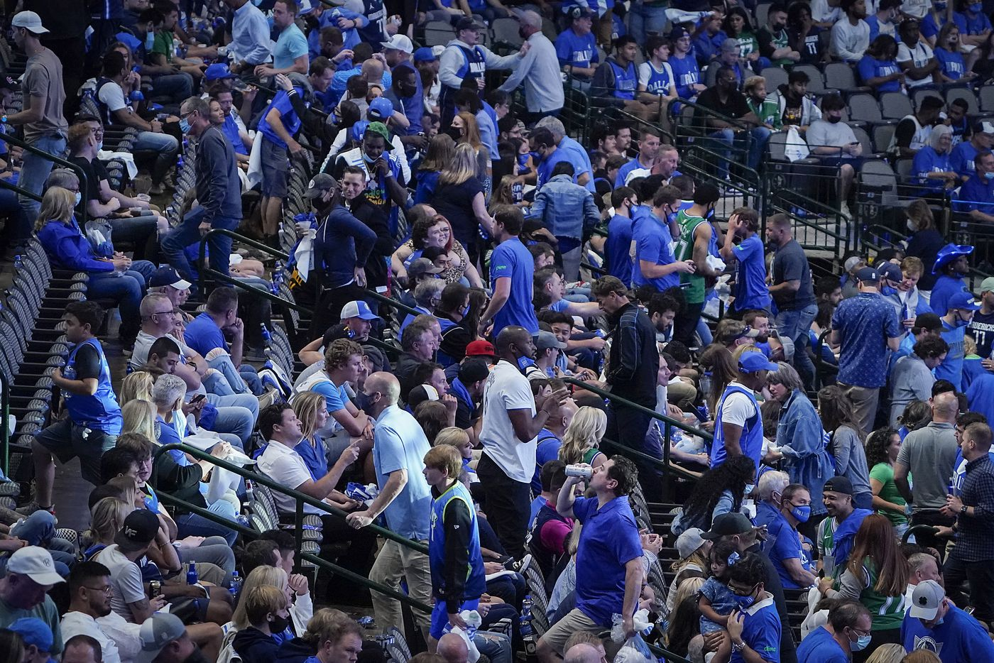 Dallas Mavericks fans head for the exits with just over four minutes left during the fourth quarter of an NBA playoff basketball game LA Clippers at American Airlines Center on Sunday, May 30, 2021, in Dallas.  The Clippers won the game 106-81.