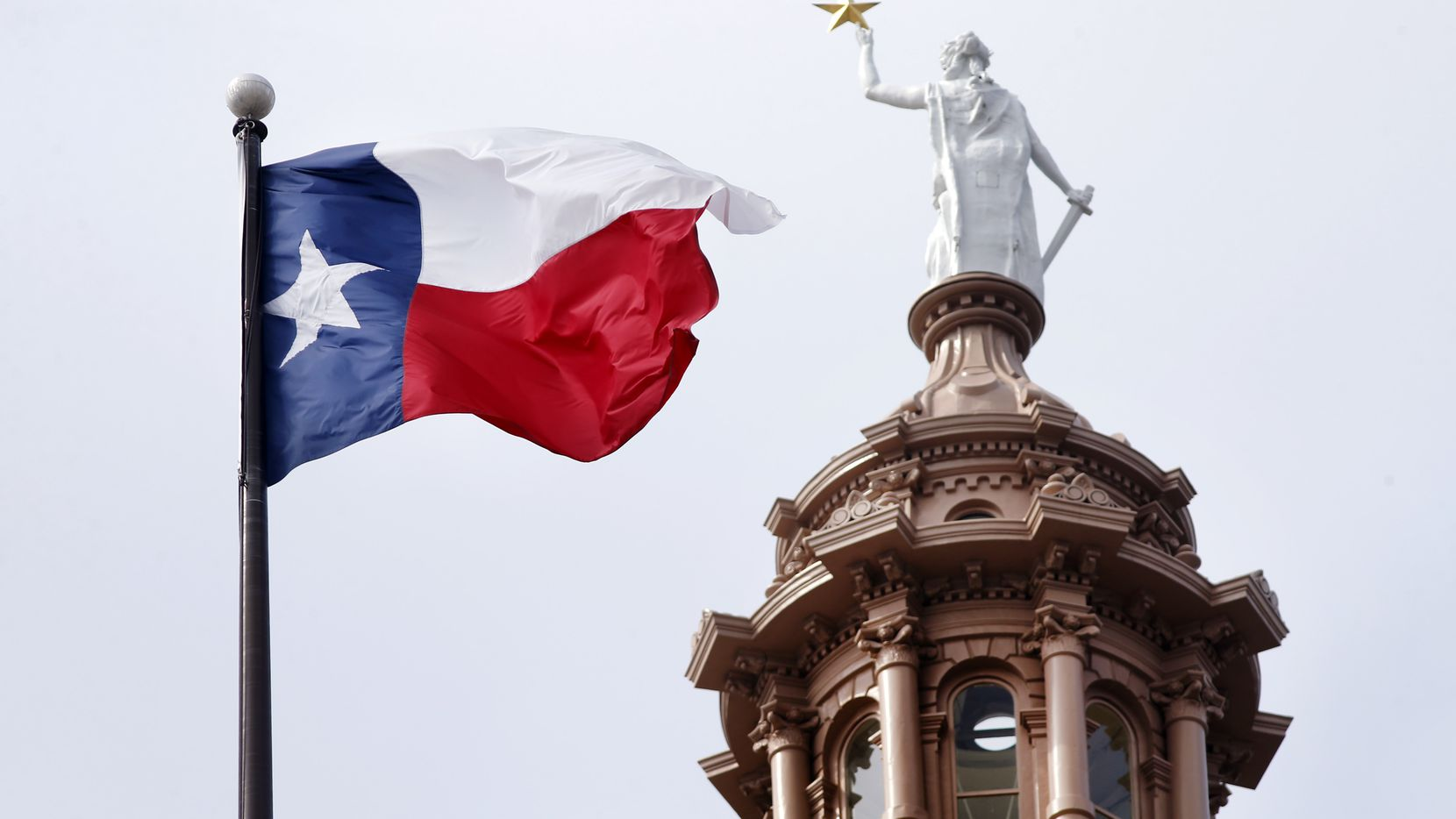 The Texas flag flies over the Texas Capitol in Austin, Texas, Wednesday, May 22, 2019. (Tom Fox/The Dallas Morning News)
