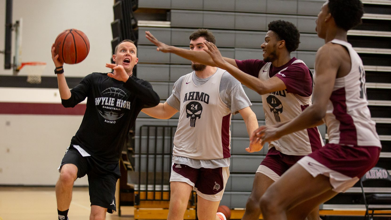 Wylie High School head basketball coach Stephen Pearce prepares to jump for a layup as he plays through a drill during practice at Wylie High School on March 11, 2020 in Wylie, Texas. (Kara Dry/Special Contributor)