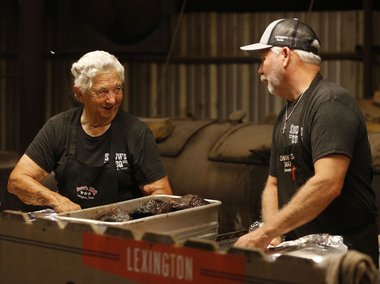 Tootsie Tomanetz and owner Kerry Bexley share a laugh as they wrap briskets in foil for the second part of their cook on the pits.