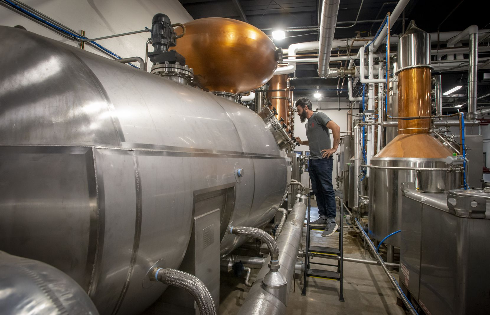 James Williams checks the still at Bendt Distilling Co. on Nov. 13, 2019 in Lewisville, Texas.