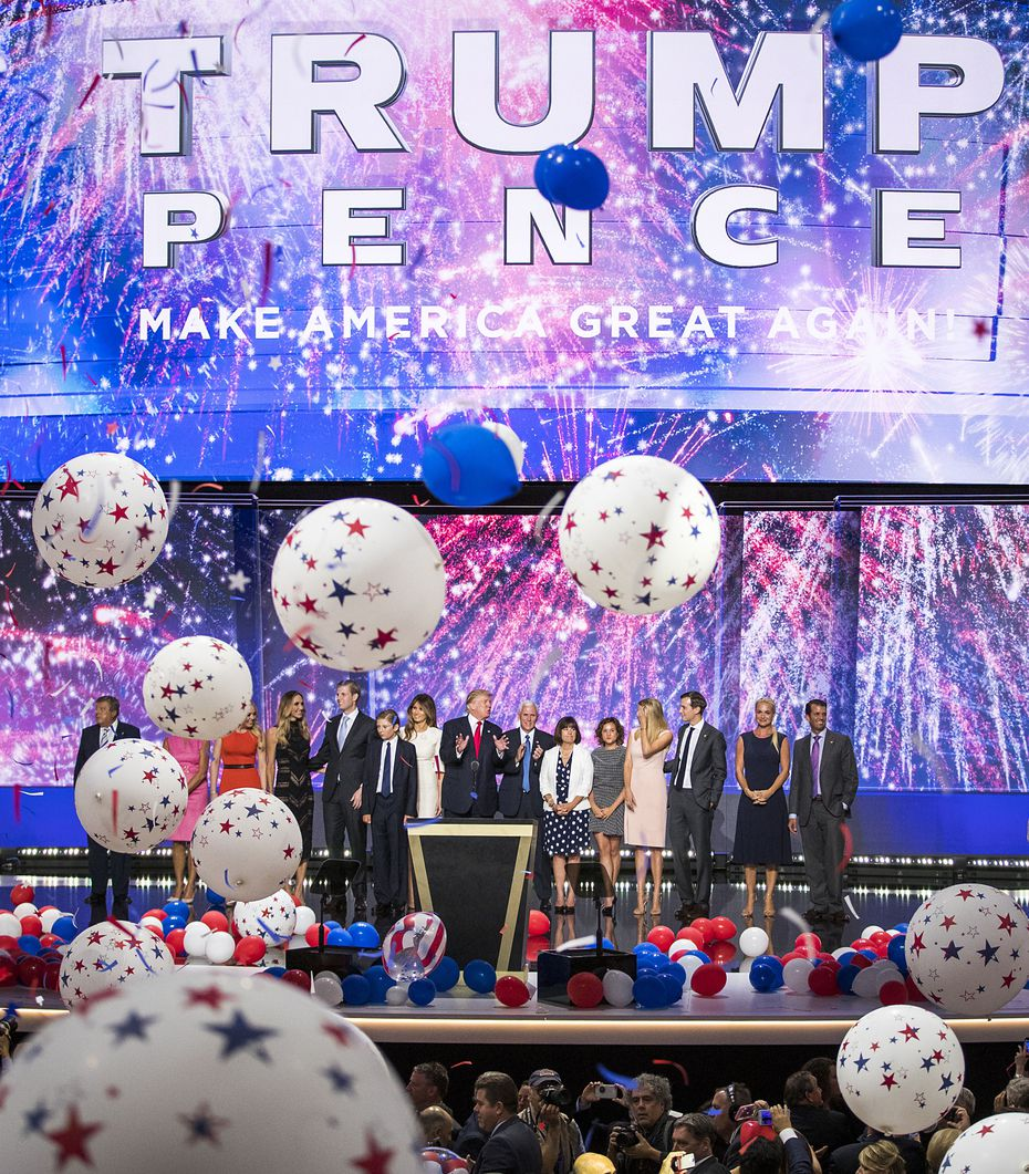 Donald Trump and Mike Pence celebrate with their families as balloons drop on the final night of the Republican National Convention.