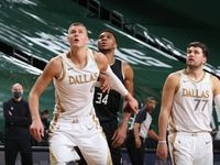 MILWAUKEE, WI - JANUARY 15: Kristaps Porzingis #6 of the Dallas Mavericks, Giannis Antetokounmpo #34 of the Milwaukee Bucks and Luka Doncic #77 of the Dallas Mavericks fight for position during the game on January 15, 2021 at the Fiserv Forum Center in Milwaukee, Wisconsin. NOTE TO USER: User expressly acknowledges and agrees that, by downloading and or using this Photograph, user is consenting to the terms and conditions of the Getty Images License Agreement. Mandatory Copyright Notice: Copyright 2021 NBAE