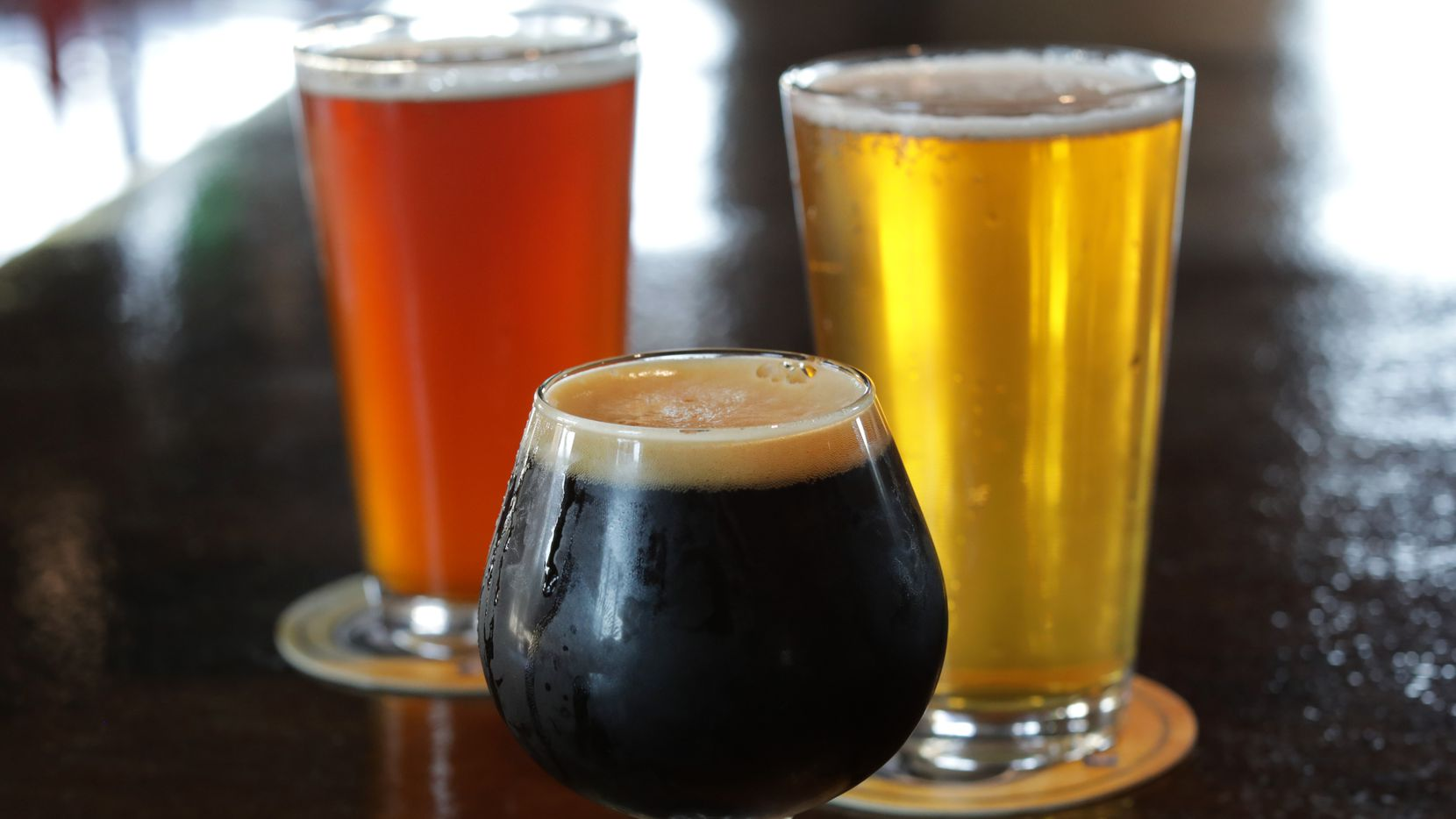 The Octoberfest, left, F*ck 2020, and Good Intentions at Cedar Creek Brewhouse and Eatery in Farmers Branch