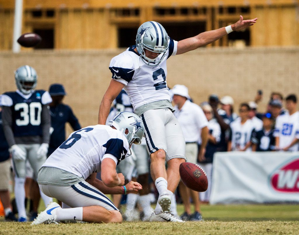 Dallas Cowboys kicker Brett Maher (2) kicks a field goal with punter Chris Jones (6) during the Blue and White Scrimmage at training camp in Oxnard, California on Sunday, August 4, 2019. (Ashley Landis/The Dallas Morning News)